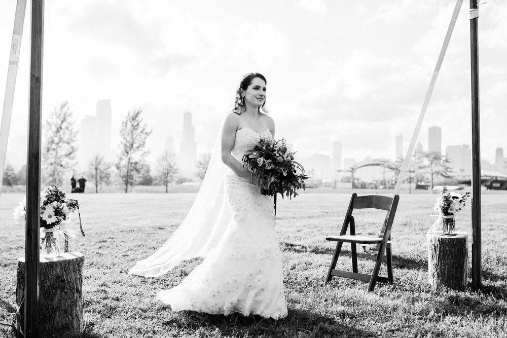 The bride walked into the tented outdoor ceremony at Northerly Island with the backdrop of Chicago behind her.