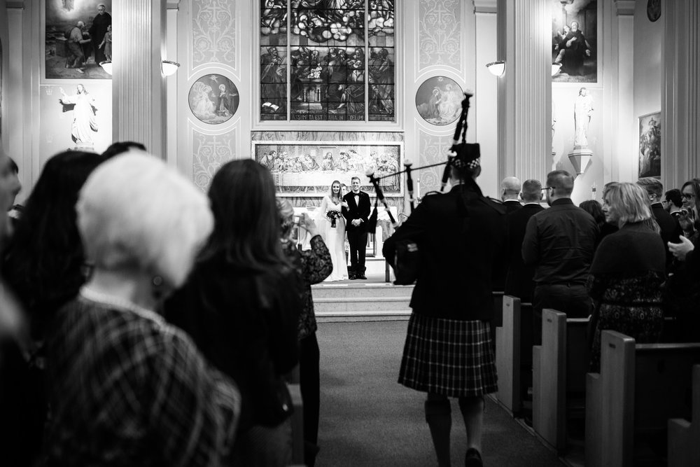 A bagpiper joined the celebration and played the bride and groom back up the aisle after they were announced husband and wife at the Assumption Church in Chicago.