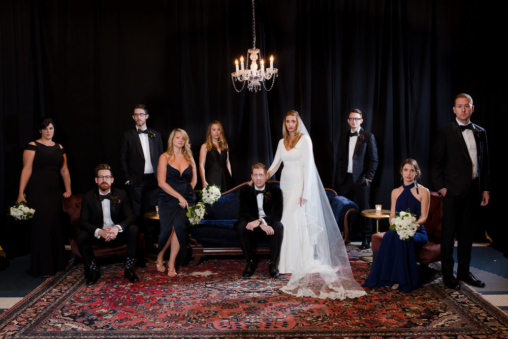 The bride told us she wanted Vanity Fair style wedding party portraits at the Chicago Athletic Association. The vintage chaise and rug beautifully accent these photos.