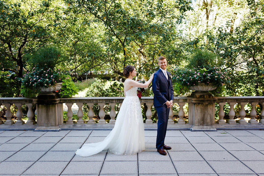 The couple wanted to have a private location for a first look, so we set them up on the terrace of the North Gardens at the Art Institute. For such a perfect early autumn day, the gardens were quiet and Sarah got rows of trees as the backdrop for her first look!