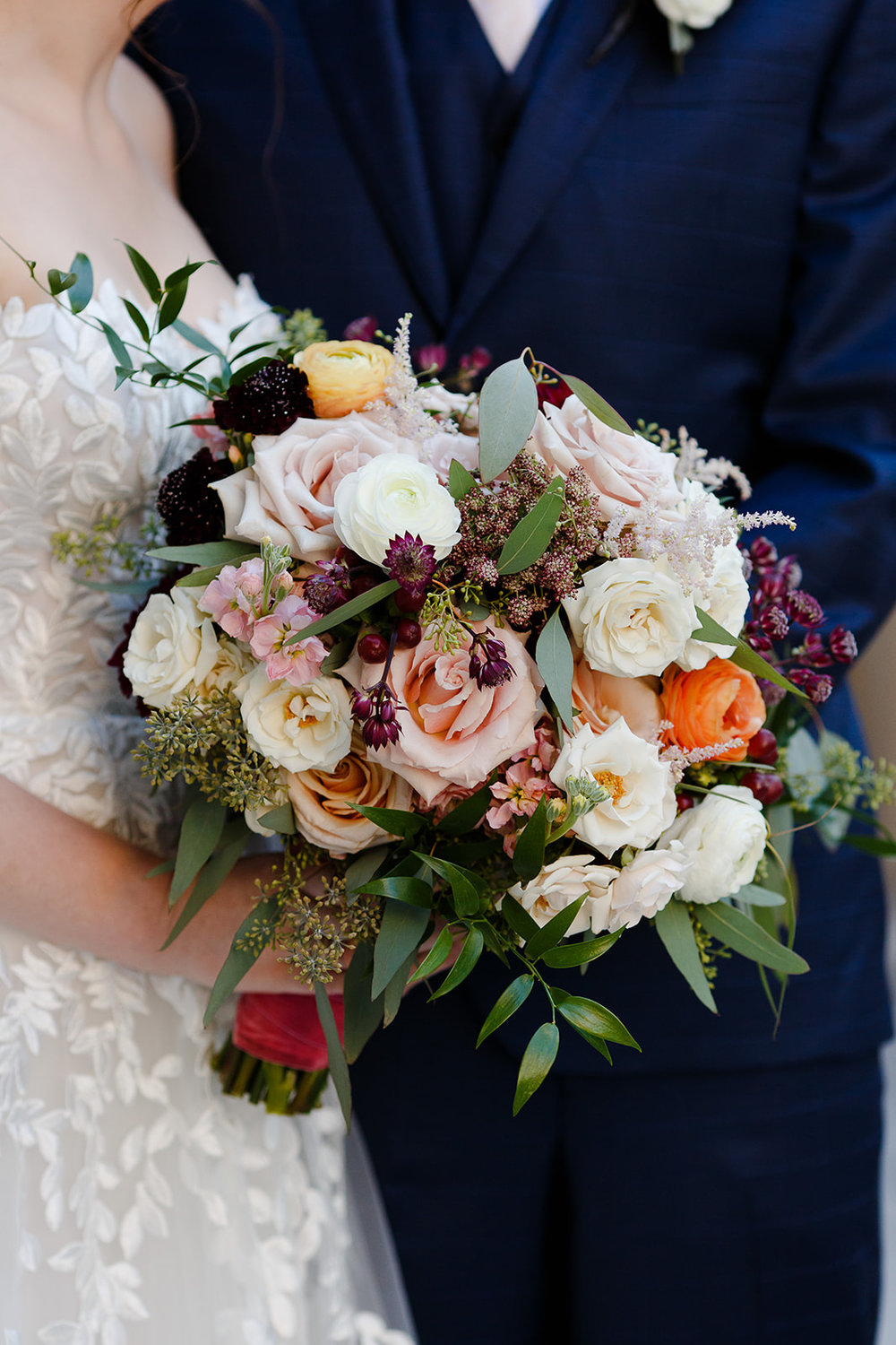 Kehoe Designs created this beautiful autumn bouquet with textured florals and greenery.