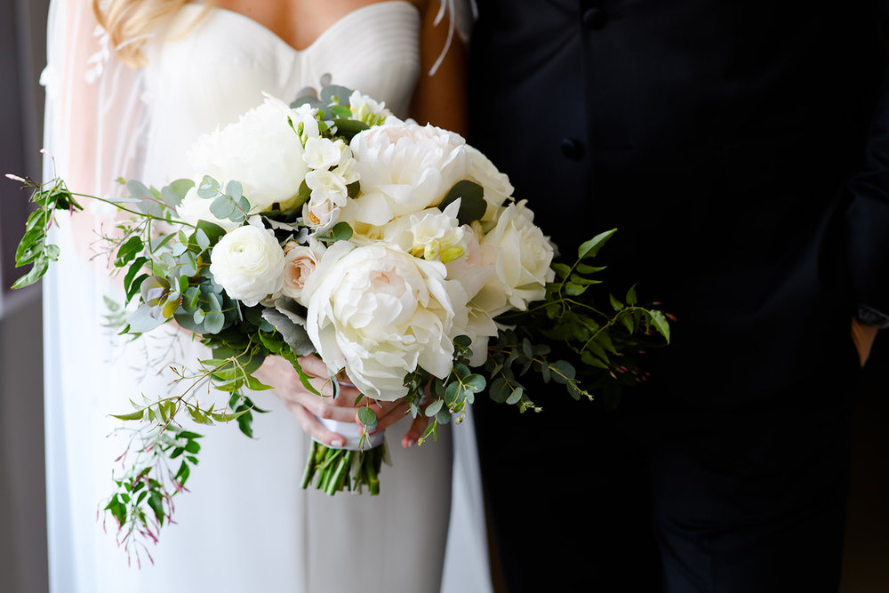 Revel Decor knocked it out of the park with this chic but romantic white bouquet. We would totally recommend a look like this for a June wedding!