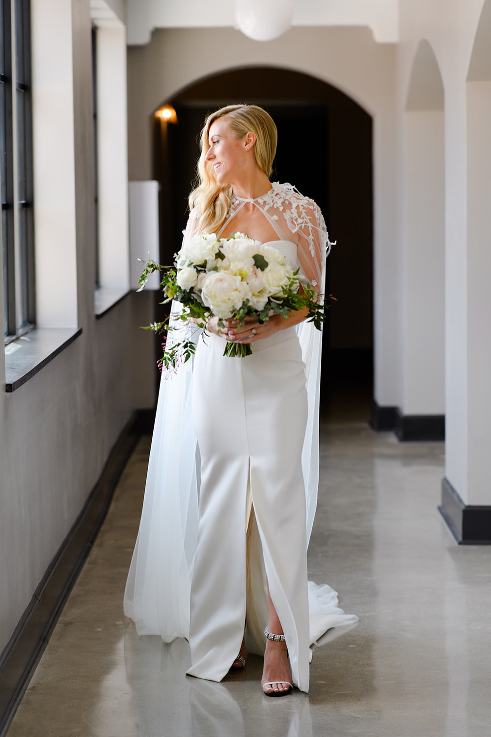 Terese was a vision in this striking sleek gown and embellished cape. She wore her hair in a deep side part and looked super chic.