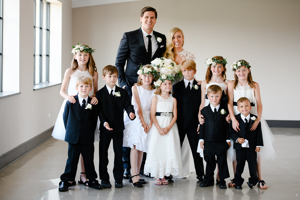 Terese and Matt had no official bridesmaids or groomsmen although they had their siblings and parents wear coordinating gowns and suits. All their nieces and nephews joined them as they walked down the aisle. What a beautiful family! This is great inspiration for couples considering having a lot of flower girls and ring bearers.