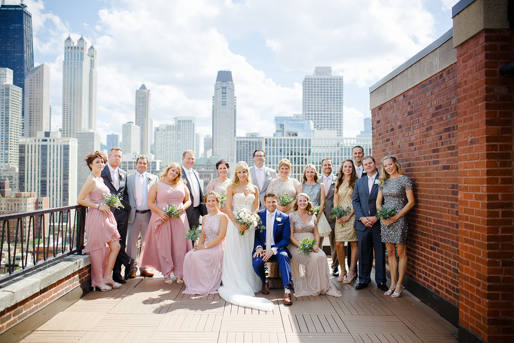 The bridesmaids wore sequined dresses and the groomsmen were in coordinating suits. The skyline was the backdrop for all of the wedding party images.