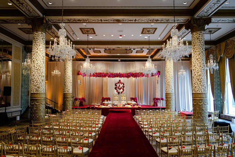 Yanni Design Studios did such a magnificent job with this ceremony in the Gold Coast Ballroom at the Drake.