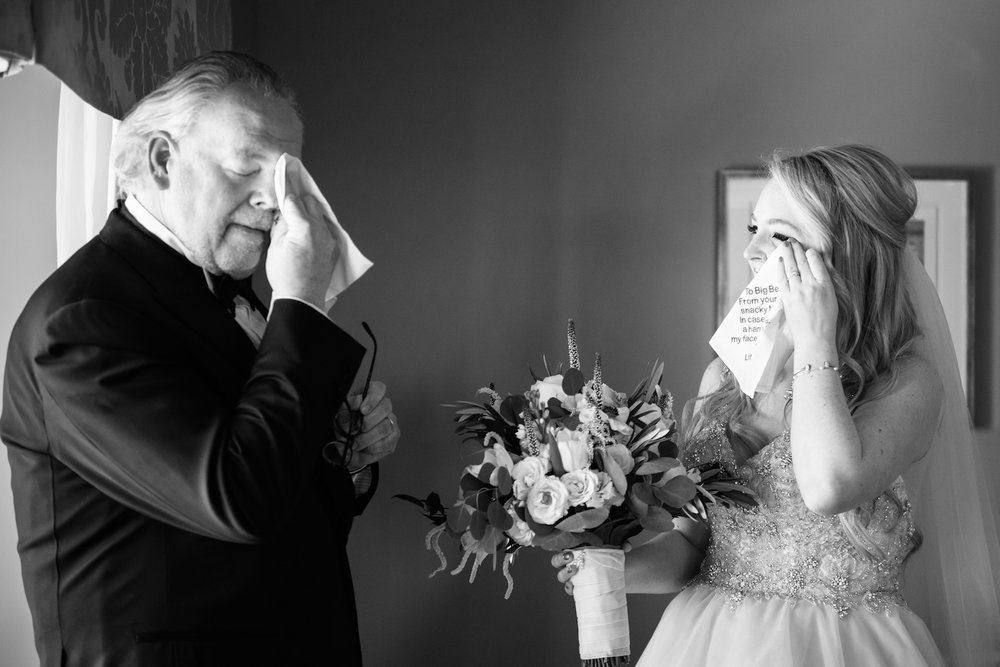 The bride and her dad shared a teary moment prior to the ceremony when Margie gave her parents custom handkerchiefs. Moments like this are why we do what we do and why we've honed our style and our vision to search out these quiet moments to photograph.