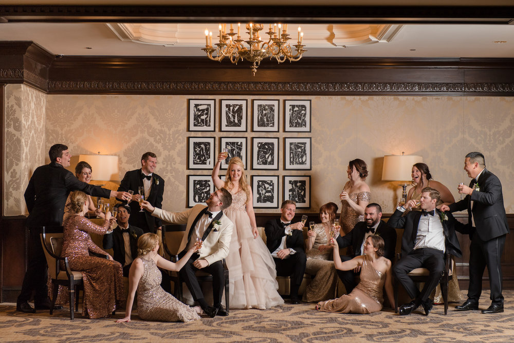 Editorial magazine-style wedding party photos are a specialty of Studio This Is! When we get to work at venues like the Four Seasons, we already have a gorgeous setting to work with and then we get to add some magic with studio lighting to create something Vanity Fair worthy.