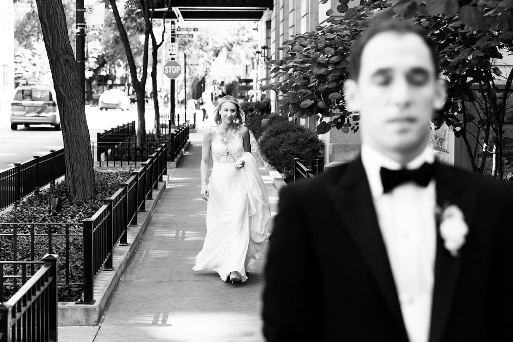 We staged the couple's first look on the sidewalk outside the Ambassador hotel, framed by the brownstones and landscaping on the street.