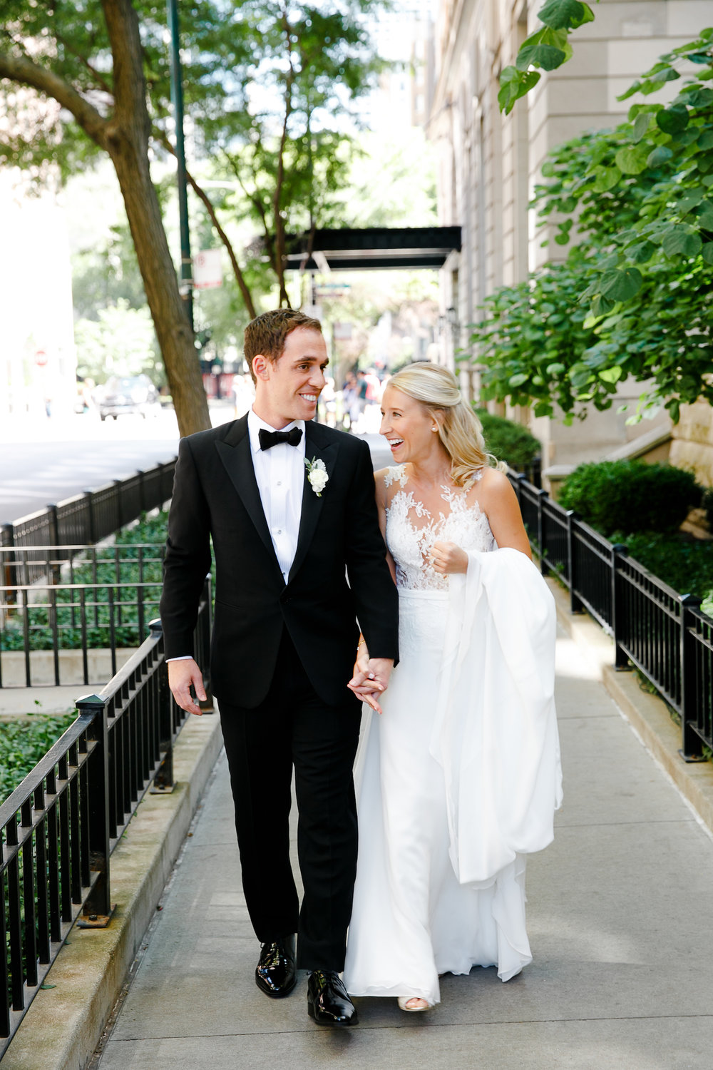 Wedding portraits in Chicago's Gold Coast show off the beauty of the old homes in the neighborhood.