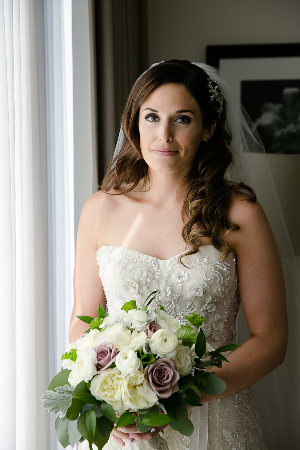 Vertical-oriented bridal portrait at the Langham's bridal suite in Chicago.
