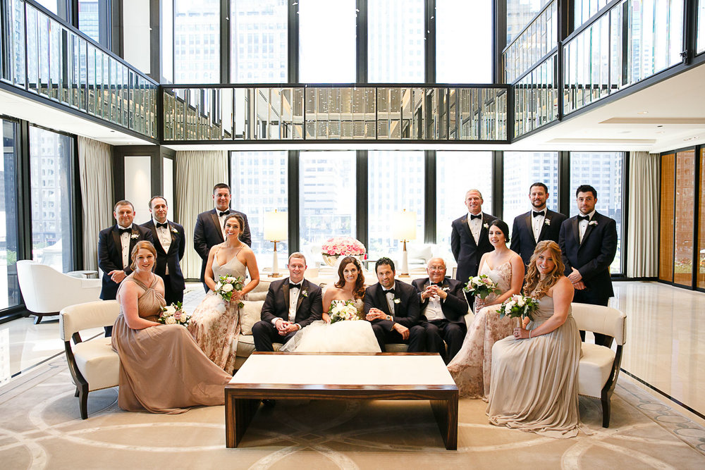 Vanity  Vanity Fair style wedding party photo in the second floor lobby of Chicago's Langham Hotel.