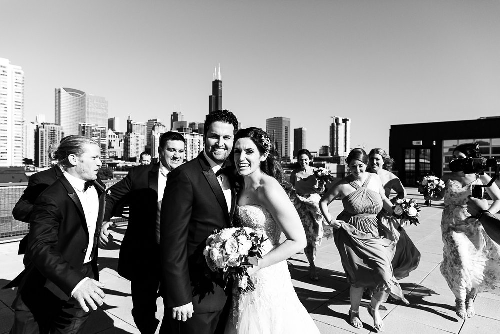 Fun high end wedding photographs with the Chicago skyline.