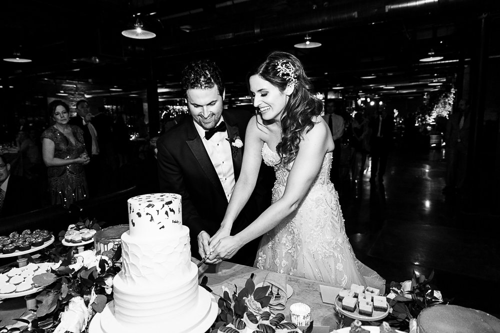 Bride and groom cut their custom wedding cake in Chicago.