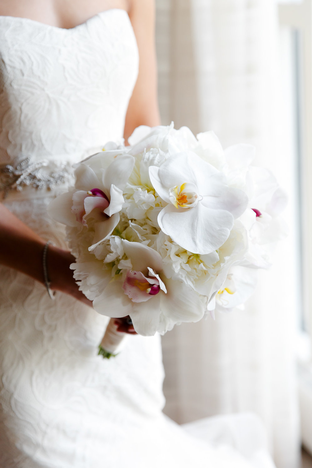 Custom bridal bouquet of orchids for high-end fashion wedding at the Peninsula on Chicago's famous Michigan Ave.