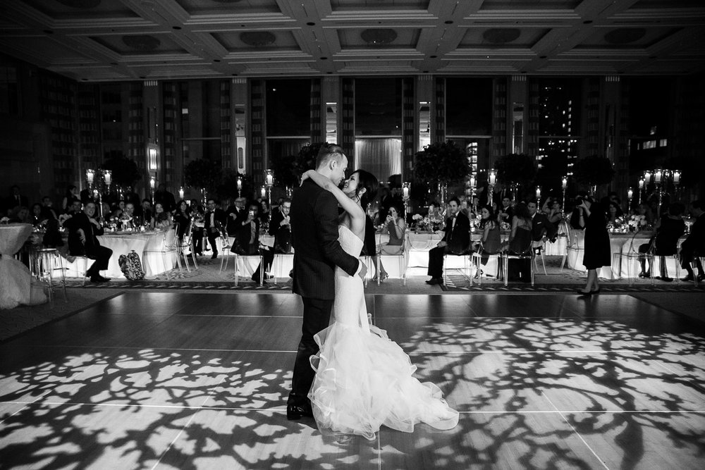 A romantic first dance under the lights of the grand ballroom at the Peninsula is the best way to kick off a high end wedding reception.