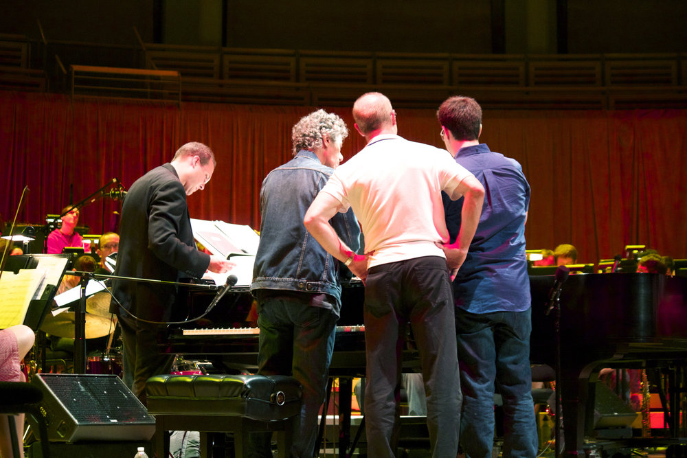 """Scott Flaving (conductor), Chick Corea (piano soloist), Shelly Berg (Frost School of Music, Dean) and Rafael Piccolotto de Lima (arranger). Rehearsal for the """"Jazz and the Philharmonic"""" concert.Arsht Center of Performing Arts, Miami."""