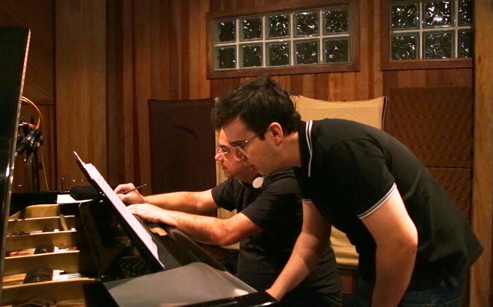Paulo Braga and Rafael Piccolotto de Lima reviewing parts.