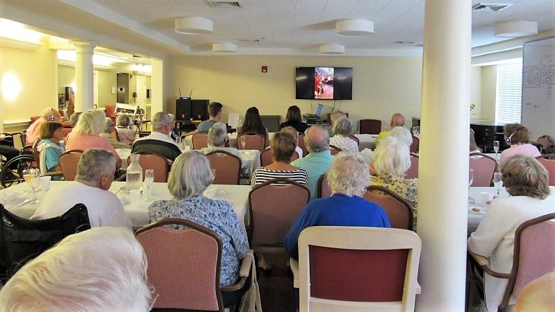 Art Rubinstein and fellow residents at Ridgefield Crossings in Ridgefield, Conn., watch live video of his granddaughter's wedding ceremony in Jerusalem last summer