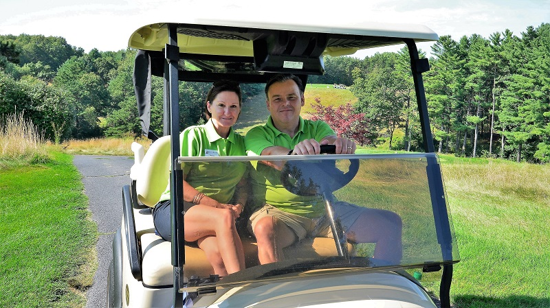Theresa Johnston , Home Office Manager and Executive Administrative Assistant, with  Guy Hemond , Vice President of Dining and Facilities, cruise around the two courses.