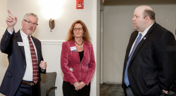 Mike Myers, regional director of sales and marketing for Benchmark Senior Living, and Susan Cwieka, campus executive director, point out key renovations to Sen. Feeney