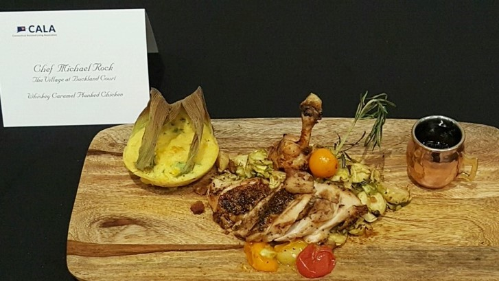 Chef Micheal Rock showcased his masterful skill with his winning chicken dish: Whiskey Caramel Planked Chicken, Jalapeno-Corn Pudding, Shaved Brussels and Pork Belly Slaw.
