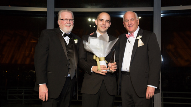 Shrewsbury Crossings Plant Operations Director  John Sullivan , middle, accepts the Beacon Award from Senior Vice President of Operations  Bob Moran , left , and Tom.