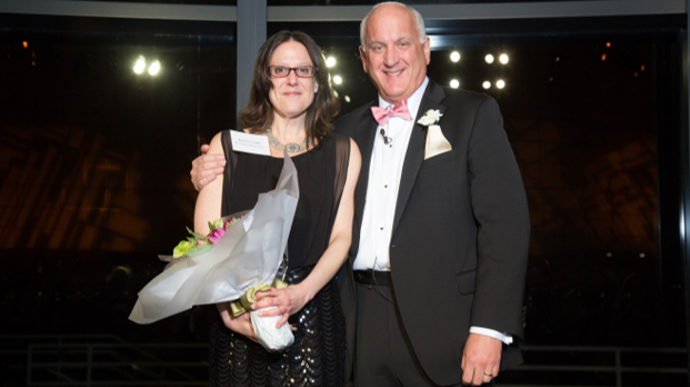 Barbara Camillo , Executive Director at  The Village at Mariner's Point, accepts the President's Award from Tom.