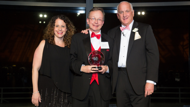 The Birches at Concord Executive Director  Chuck Crush , center, accepts the Circle Award from  Allison Melahouris and Tom.