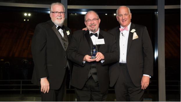 Edgehill Executive Director  Chris Barstein , center,accepts the Ripple Award from Bob Moran and Tom.