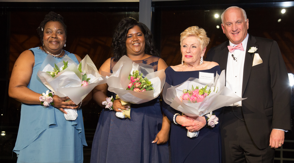 Onstage with Tom, from left,   Norrett Burnett   with finalists   Chlea Bynoe  , Lead Front Desk Receptionist at   The Falls at Cordingly Dam  , and   Sandra Papasedero  , Concierge at   The Commons in Lincoln  .