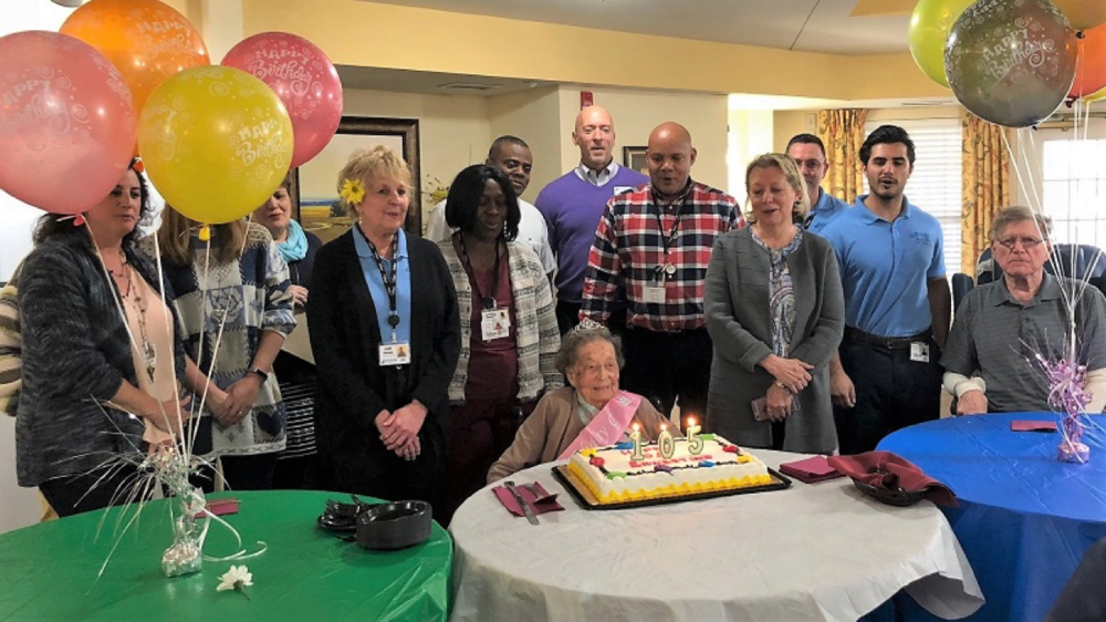 Family, residents and associates celebrate Ernestine Gierman's 105th birthday.