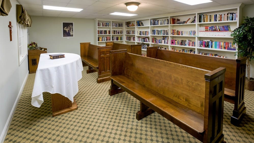 The pews and bookshelves in the original chapel.