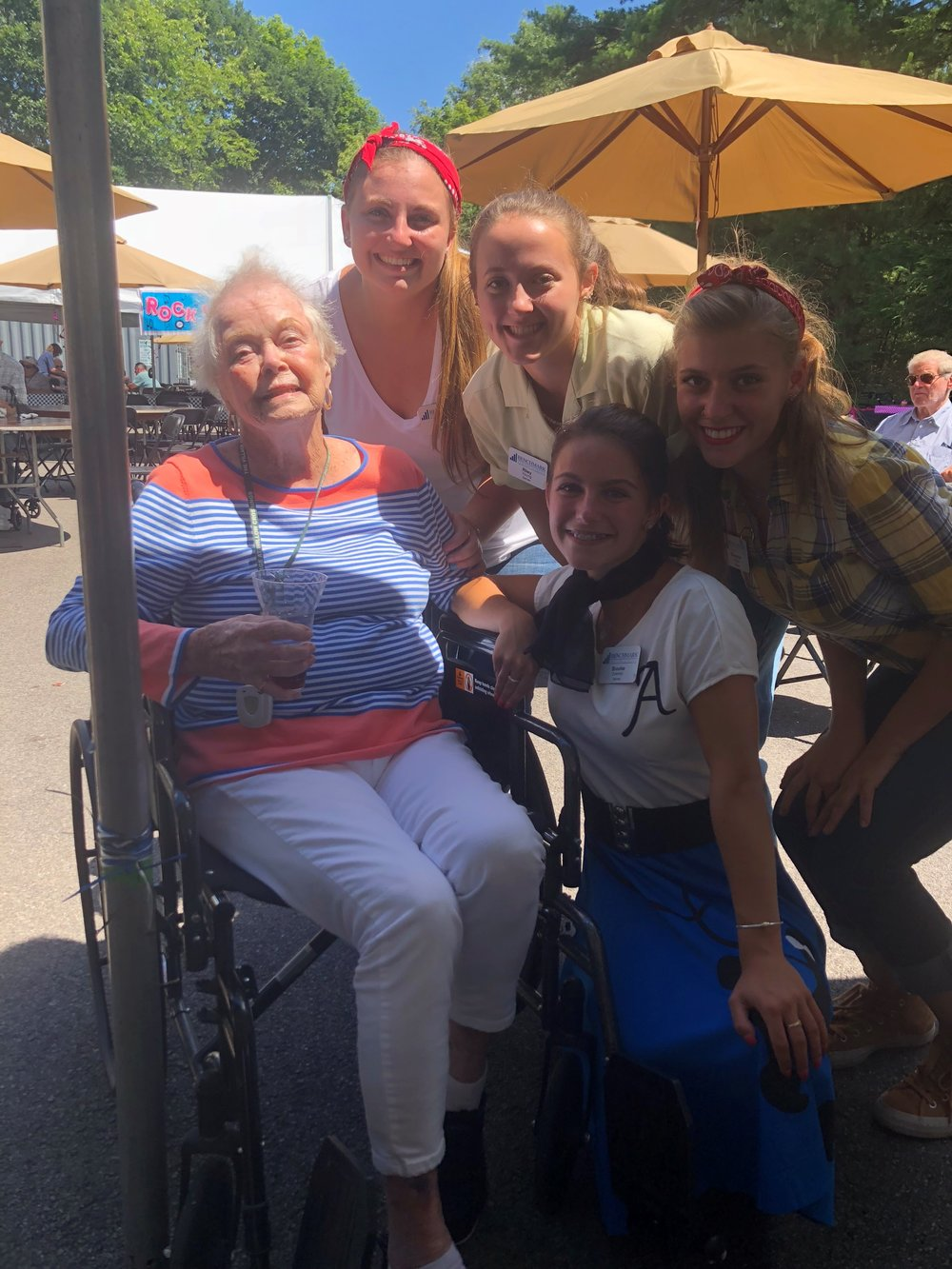 From left, resident Carol Mariani, with servers Anna Kemp, Riley Young, Shannon Felice and Brooke Downey.