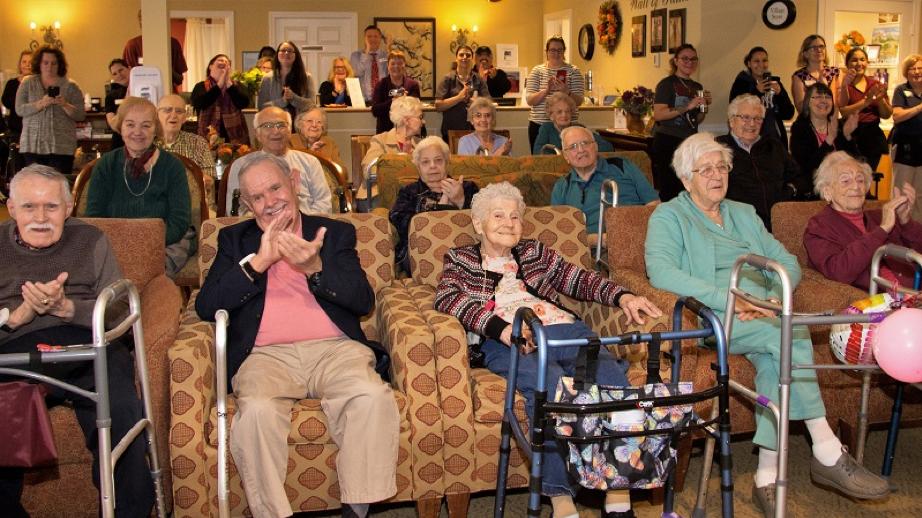 Residents and associates enjoy the celebration.