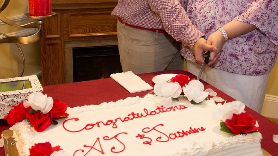 Jasmine and A.J. cut thecake.