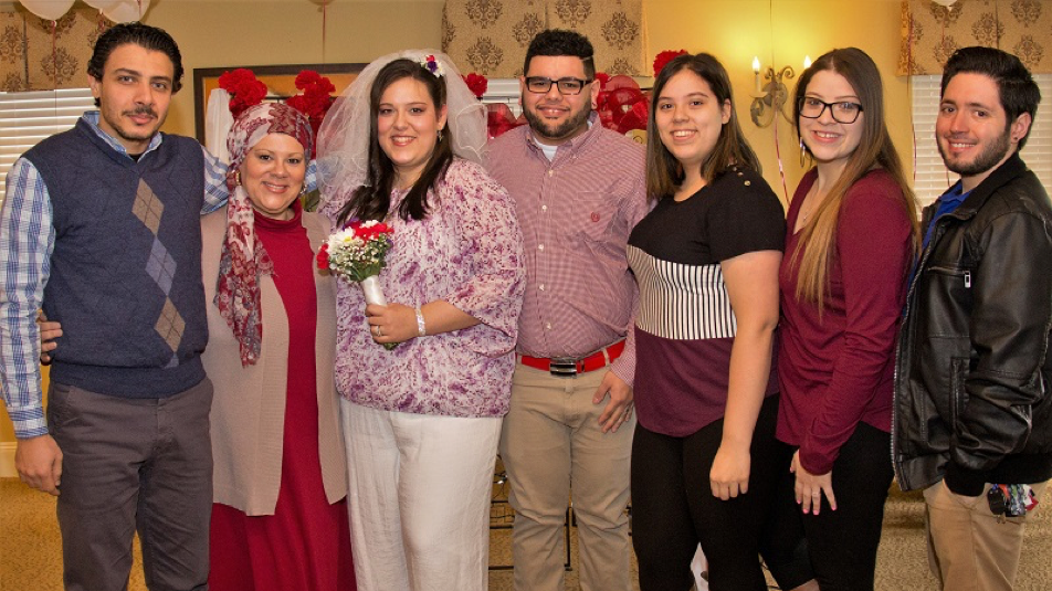 From left, Maju Salama, Jasmine's stepfather; Nitsy Ortiz, Jasmine's mother; Jasmine and A.J. Rosa, Jenesi and Jennelis Polanco, Jasmin's sisters; and Leo Olivero, Jasmine's brother-in-law