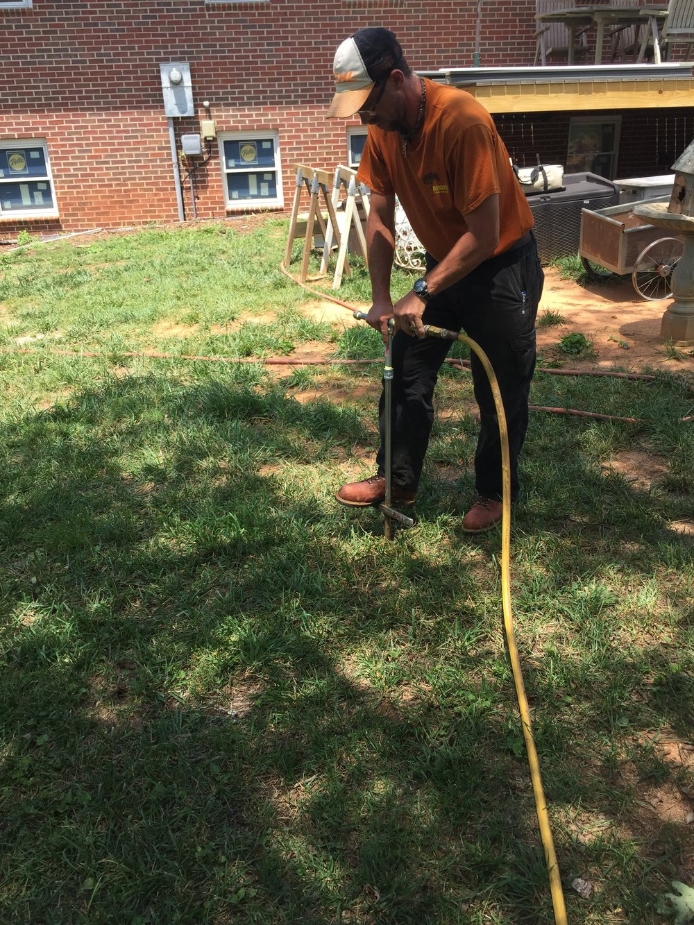 Limbwalkers Tree & Crane Service expert performing deep root fertilization tree service in Morganton, NC.