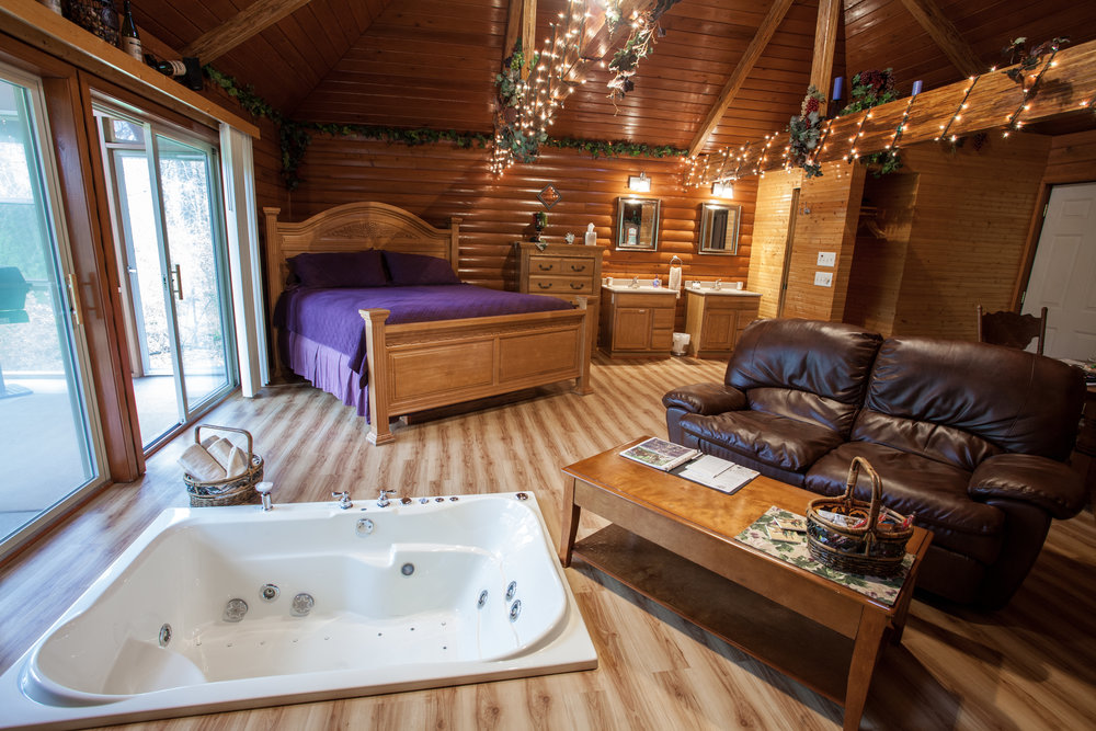 interior cabin photo hot tub and king size bed