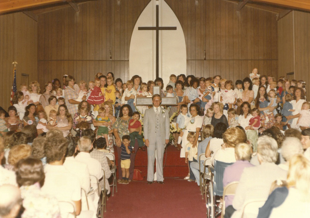 Pastor Melton on Baby Day '78 in the original Worship Center (currently, the Student Center).