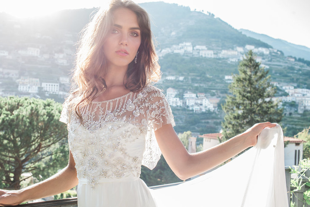 Anna Campbell Bridal | Eternal Heart Collection | Adele Dress. Vintage-inspired embellished wedding dress, with sheer illusion neckline and low back detail | Styled with the Natalia Chandelier Earrings