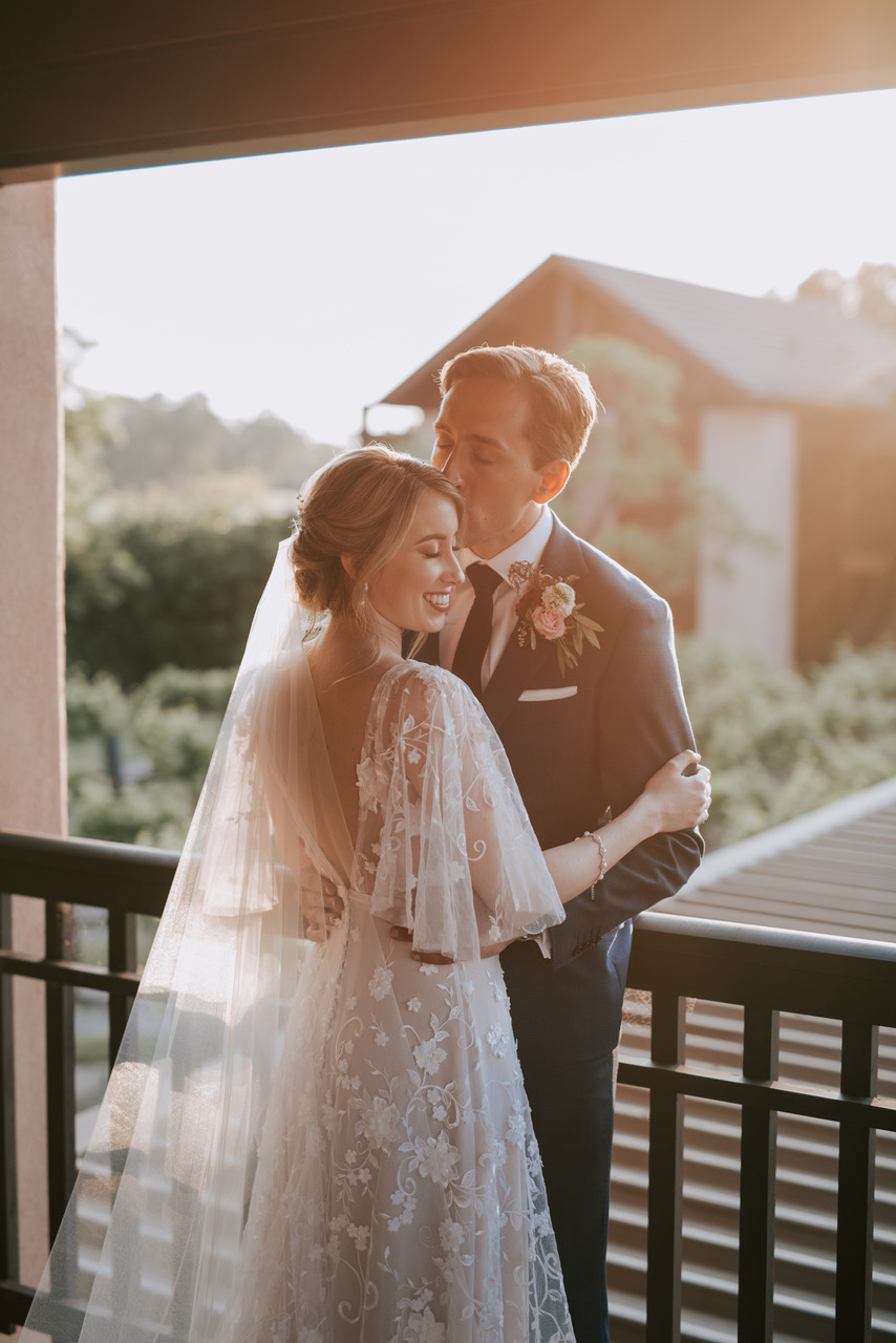 """I absolutely adored the delicate, flowing sleeves, the open back and the lovely embroidery and 3D flower embellishments which cover the dress. It's such a romantic and whimsical look."" -"