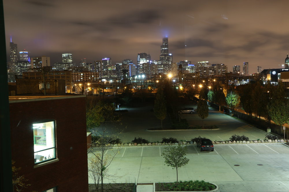 View of the Chicago Skyline and parking lot from the Boelter Event Center.
