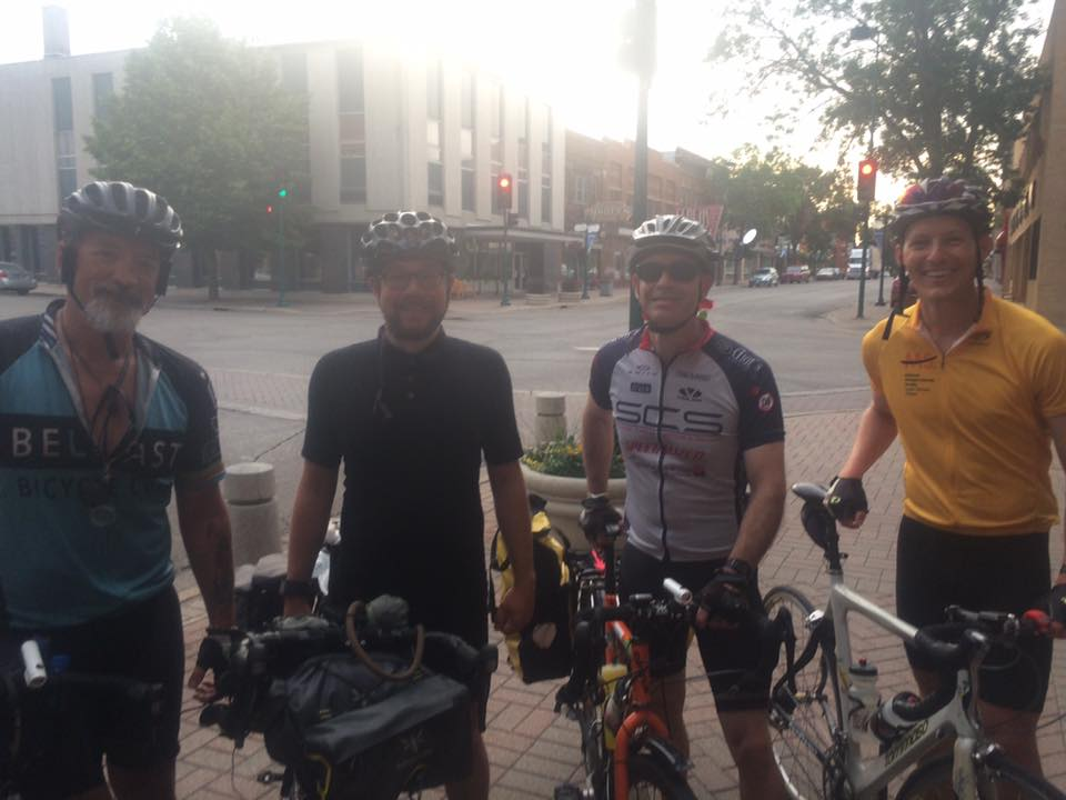 Hans and Mike standing with two other bicyclists in the morning fog