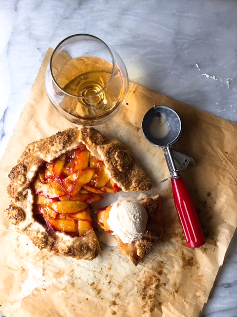 Nectarine Cardamom Vanilla Galette with Grand Marnier   *CRUST   1 1/4 Cups All Purpose Flour  1/4 teaspoon Fine Sea Salt  1/2 teaspoon Cane Sugar  7 Tablespoons Very Cold Cubed Unsalted Butter  5 Tablespoons Ice Cold Water  In a Food Processor place Flour, Salt and Sugar and mix together. Add Cold Cubed Butter and pulse until crumbly. You still want to see some pieces of Butter throughout. Slowly, add Ice Water about 1 T. at a time until the dough comes together and forms a ball... Turnout on lightly floured surface and form into a disc. Wrap tightly with Plastic Wrap and place and chill in refrigerator at least 1 hour. I prefer to chill mine overnight...   *FILLING   3 Unpeeled Nectarines sliced thin  1 teaspoon Fresh Lemon Zest  1 Tablespoon Fresh Lemon Juice  1 Tablespoon Grand Marnier   1/2 Vanilla Bean Scraped  3 Tablespoons Tapioca Flour  2 Tablespoons Cane Sugar  1/2 teaspoon Ground Cardamom   1/8 teaspoon Fine Sea Salt   *TOASTED ALMOND FILLING   1/4 Cup Toasted Almonds  2 Tablespoons Vanilla Demerara Sugar or regular  2 Tablespoons All Purpose Flour  Pulse in Food Process or until finely ground.  Remove dough from refrigerator and make Nectarine Filling. Place Nectarines, Zest, Lemon Juice, Grand Marnier and Vanilla Seeds in a bowl. Mix with spatula then add Flour, Sugar, Cardamom and Salt. Mix again with spatula and set aside 15-20 minutes. Stir 3-4 times while resting. During this time roll out your dough and keep it as cold as possible.   *EGG WASH   Whisk one egg with 1 teaspoon of water   *ASSEMBLY    On lightly floured board or surface, roll out dough on Parchment. This makes it easier to shift and move to get a more circular shape. Work fast because you want to keep your dough chilled. Spoon Almond Filling on rolled out dough and keep a border. Lay fruit down over Almonds still keeping the border. Gently fold up dough around fruit and pastry in a circular motion and keep the same direction as you go until all the fruit is wrapped up. Brush with the Egg Wash and sprinkle with Demerara Sugar. Freeze 45 minutes up to one hour. In the meantime make the glaze and preheat your oven to 425.   *GLAZE   1 Tablespoon Peach or Apricot Preserve  1 Tablespoon Grand Marnier  Remove Galette from the freezer and place on clean Parchment on Baking Sheet. Place in the oven and bake for 30 minutes at 425. Reduce the heat to 375 and bake another 30-40 minutes until filling is bubbling and crust is Golden Brown.  While Galette is still hot, spoon the Glaze over, you may not need all of it. Cool for at least 30 minutes and if desired the remaining glaze can be served over the top with Vanilla Bean Ice Cream... Delicious!!