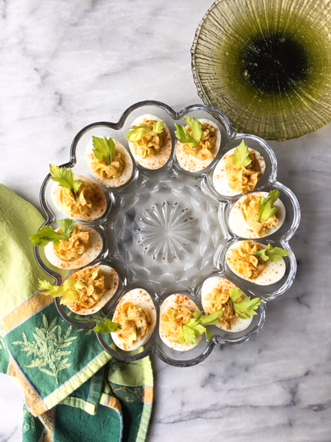 Deviled Eggs on vintage egg plate.