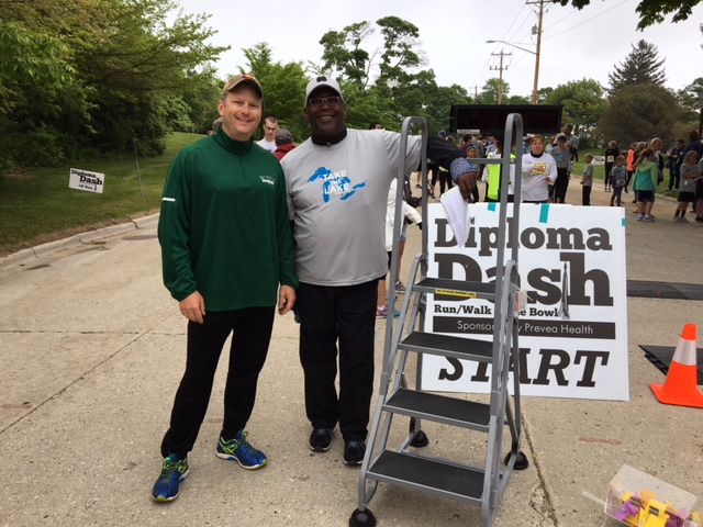 SPEF President Brian Versey, left and Jerry Jones, Vice President, right get ready to address the runners before the 2018 run/walk
