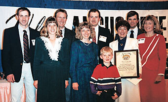 The Sitz family reciving the plaque inducting Robert L. Sitz into the American Angus Heritage Foundation posthumously.