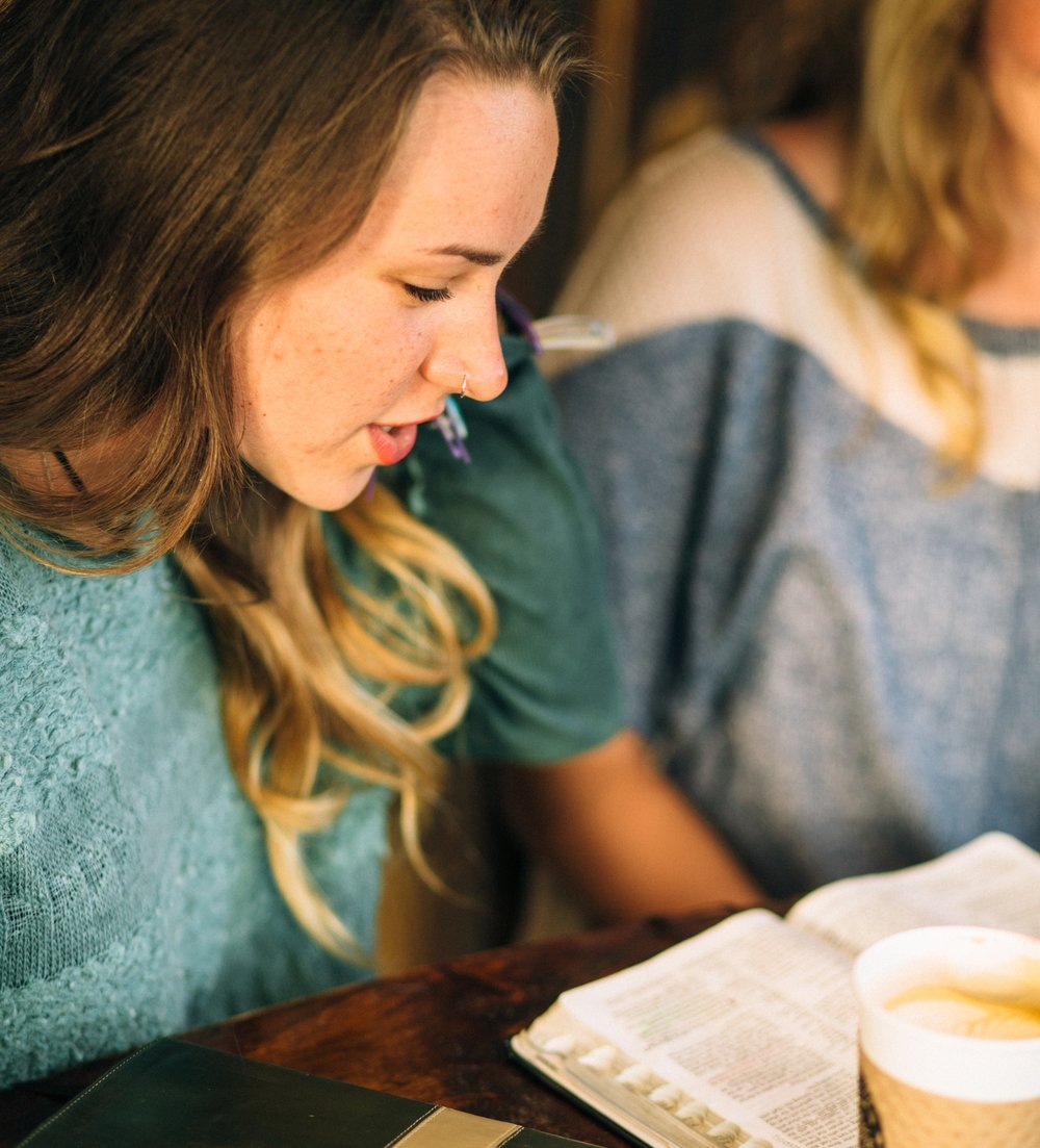 Young woman, praying, bible, coffee, bible study.jpg