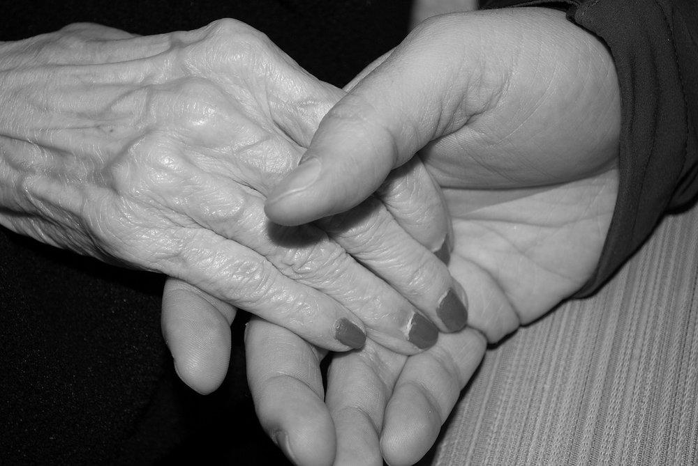 elders holding hands